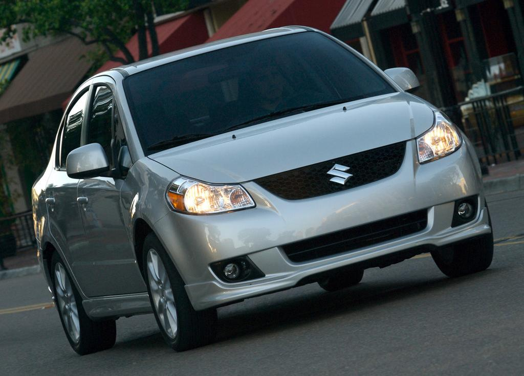 Should I get a sports car or a VITZ?? Crazy question, great confusion, need help! - maruti sx4 diesel